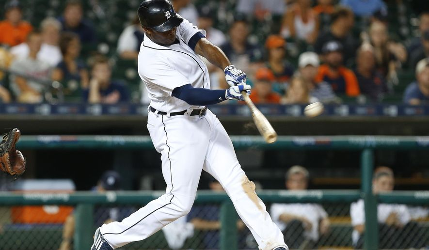 Detroit Tigers' Justin Upton hits a walk-off solo home run against the Seattle Mariners during the 12th inning of a baseball game in Detroit, Monday, June 20, 2016. Detroit won 8-7. (AP Photo/Paul Sancya)