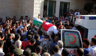 Jordanian soldiers and relatives of Jordanian soldier Belal Al-Zuhbi carry his coffin near the city of Jerash, north of Amman, Jordan, Tuesday, June 21, 2016. A suicide attacker driving a truck packed with explosives barreled through Syria's border with Jordan, setting off a blast that killed six members of the Jordanian security forces and wounded 14. A government spokesman says Jordan is sealing the border area, leaving it unclear how international aid will reach some 64,000 Syrian refugees stranded on the other side. It was the deadliest attack along the tense border in recent memory. (AP Photo/Raad Adayleh)