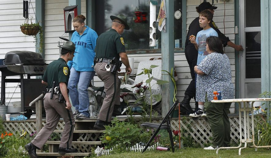 FILE- In this July 27, 2011, file photo New Hampshire State Police troopers enter the family home of Celina Cass, in Stewartstown, N.H. Wendell Noyes, 52, of Stewartstown, stepfather of 11-year-old Cass who was found dead in a river in 2011, was arrested Monday on a second-degree murder charge in her killing. (AP Photo/Charles Krupa, File)