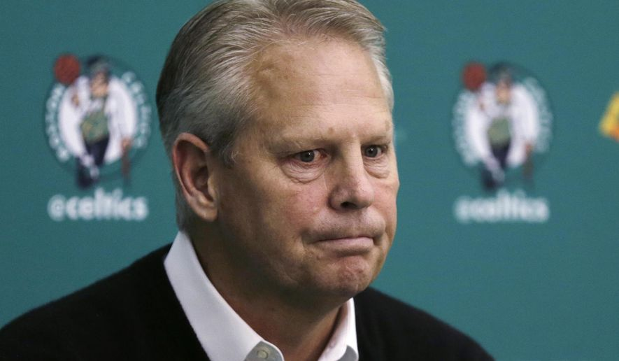 FILE - In this May 17, 2016 file photo, Boston Celtics President of Basketball Operations Danny Ainge pauses while answering a reporter's question at the basketball team's training facility in Waltham, Mass.  Ainge became a marvel among his fellow league executives in 2007 when he pulled together the mega deal that would become Boston's Big Three and subsequent NBA championship. With eight picks to play with entering Thursday, June 23 draft, Ainge again finds himself in a unique spotlight, and bargaining position, as the Celtics look to use the draft to transform into a player again in the Eastern Conference. (AP Photo/Charles Krupa, file)