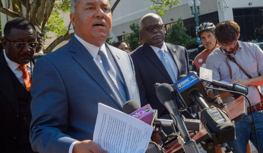 Orleans Parish Sheriff Marlin Gusman, center, speaks during a press conference across from Federal Court in New Orleans, La., Tuesday, June 21, 2016. Gusman, elected to run the long-troubled New Orleans jail, agreed Tuesday to cede management of the lockup to an outsider, heading off the possibility that a federal judge would strip him of his chief duty amid continued reports of violence among inmates. (Matthew Hinton/The Advocate via AP) MANDATORY CREDIT