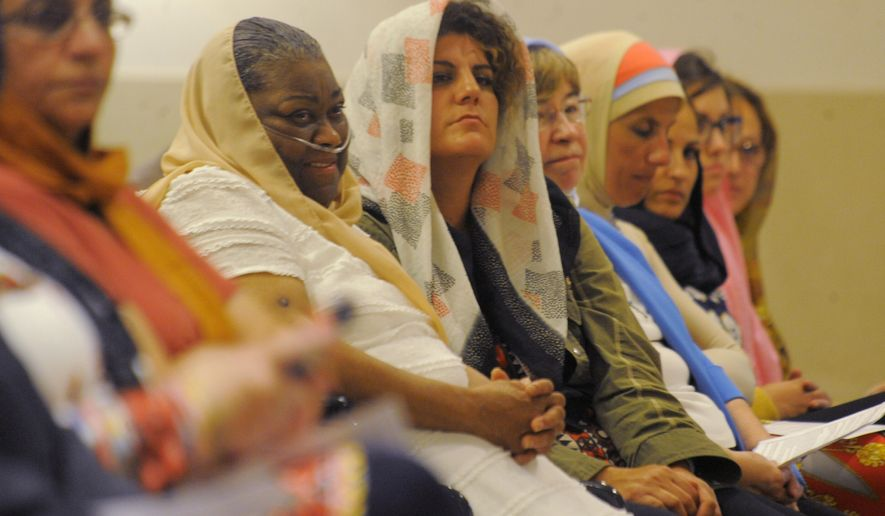"In this  Monday, June 20, 2016 photo Attendees listen to speakers during an Memorial Prayer Service in memory of the victims of shootings in Charleston, S.C., in 2015 and recently in Orlando, Fla., at the Islamic Center of America in Dearborn, Mich. Imam Mohammad Ali Elahi of Islamic House of Wisdom in Dearborn Heights said unity means ""replacing racism with respect, revenge with reconciliation, injustice with equality, isolation with outreach."" (Steve Perez/Detroit News via AP)  DETROIT FREE PRESS OUT; HUFFINGTON POST OUT; MANDATORY CREDIT"