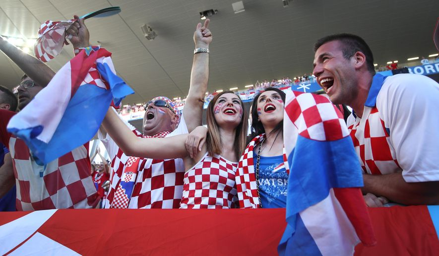 Croatian fans cheer prior to the Euro 2016 Group D soccer match between Croatia and Spain at the Nouveau Stade in Bordeaux, France, Tuesday, June 21, 2016. (AP Photo/Petr David Josek)