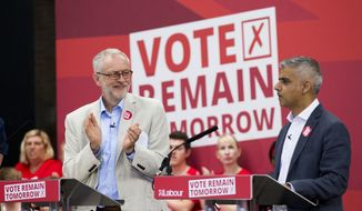 "The leader of Britain's opposition Labour Party Jeremy Corbyn, left, applauds London mayor Sadiq Khan as he makes an address during a European Referendum ""Remain"" rally in London, Wednesday, June 22, 2016. Britain votes whether to stay in the European Union in a referendum on Thursday. (AP Photo/Matt Dunham)"