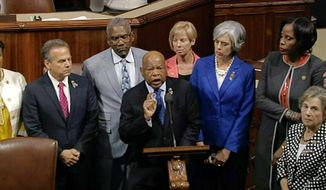 In this frame grab taken from AP video Georgia Rep. John Lewis leads more than 200 Democrats in demanding a vote on measures to expand background checks and block gun purchases by some suspected terrorists in the aftermath of last week's massacre in Orlando, Florida, that killed 49 people in a gay nightclub.  (AP Photo)