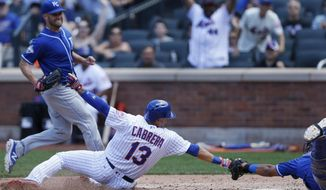Kansas City Royals starting pitcher Danny Duffy, upper left, watches as New York Mets' Asdrubal Cabrera (13) scores past a diving Royals catcher Salvador Perez during the fifth inning of an interleague baseball game Wednesday, June 22, 2016, in New York. (AP Photo/Kathy Willens)