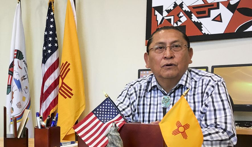In this June 8, 2016, photo, Gov. Kurt Riley, of Acoma Pueblo, discusses his tribe's move to repatriate a ceremonial shield from Paris, France during an interview in Acoma Pueblo, New Mexico. Amid protest from the Pueblo, the shield was pulled from the auction block in a rare, last-minute move that has been hailed by tribes and questioned by some collectors. (AP Photo/Mary Hudetz)