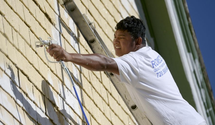 ADVANCE FOR WEEKEND EDITIONS, JUNE 25-26 - In this photo taken Wednesday, June 15, 2016, Romeo's Quality Painting employee Edgar Ortiz paints the south side cedar shake gable at the historic Highlandlake Church in Mead, Colo. The 120-year-old church is getting some improvements this summer with the help of high school students and businesses.(Lewis Geyer/Daily Camera via AP) NO SALES; MANDATORY CREDIT