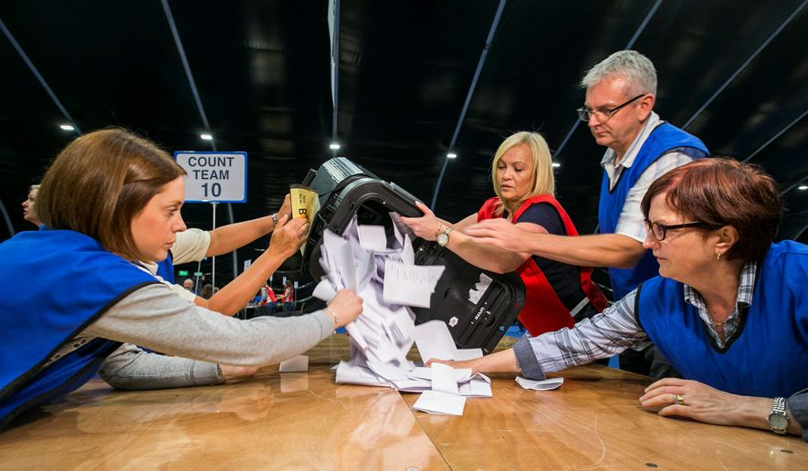 Workers begin to count ballots Thursday at the Titanic Exhibition Center in Belfast, Northern Ireland, in the long-anticipated national referendum on whether Britain should remain a member of the European Union, which it joined in 1973. (Associated Press)