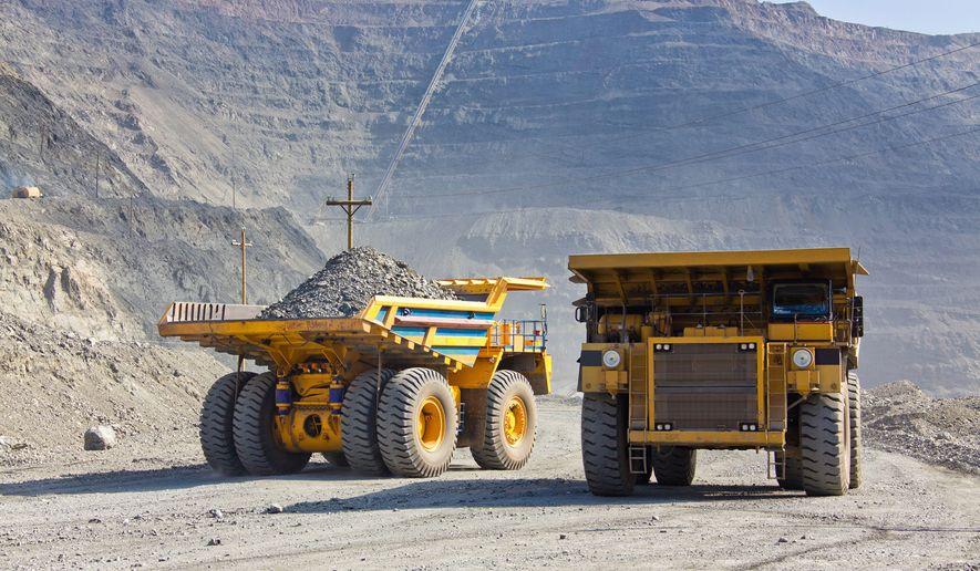 Giant copper ore trucks in open pit mine (Photo: Shutterstock)