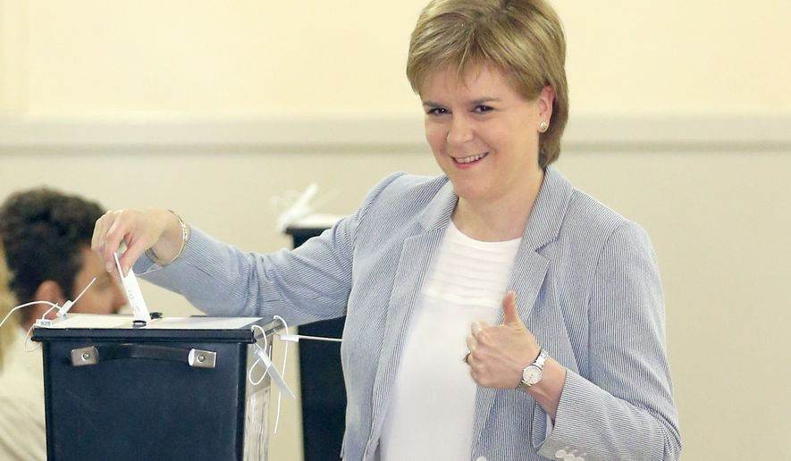 Scotland's First Minister, Nicola Sturgeon, casts her vote in Glasgow, Scotland, Thursday June 23, 2016, as voters head to the polls across the United Kingdom in a historic referendum on whether the UK should remain a member of the European Union or leave. (Jane Barlow/PA via AP)  UNITED KINGDOM OUT  NO SALES NO ARCHIVE