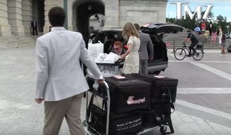 """According to footage caught by TMZ, Democrats accepted a massive shipment of Chick-fil-A just outside the Capitol. """"Is this all for us?"""" said one woman, apparently a staffer, as she pushed one of two loaded carts onto the pavement. (TMZ)"""