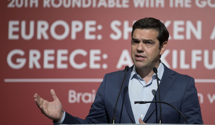 Greek Prime Minister Alexis Tsipras gives a speech during an Economy conference, in Lagonisi southeast of Athens, on Thursday, June 22, 2016. Greece's left-led government wants to ease its budgetary saving commitments after its current multi-billion euro bailout ends in 2018, a senior official says.(AP Photo/Petros Giannakouris)