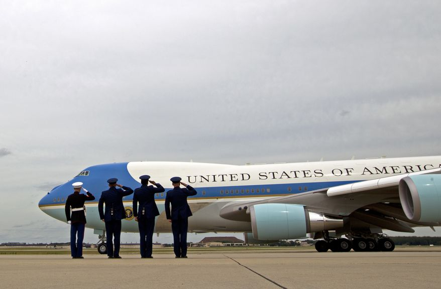 Military personnel salutes as Air Force One, with President Barack Obama aboard, departs, Thursday, June 23, 2016, from Andrews Air Force Base, Md. Obama is traveling to the San Francisco-Bay Area today and attending a Global Entrepreneur Summit at Stanford University tomorrow. . (AP Photo/Jose Luis Magana)