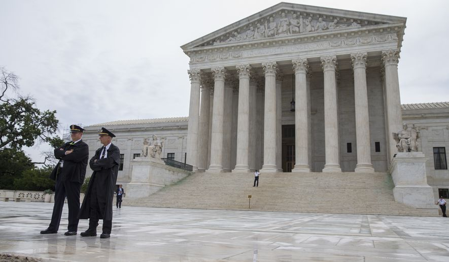 Police stand outside the Supreme Court in Washington, Thursday, June 23, 2016. (AP Photo/Evan Vucci)
