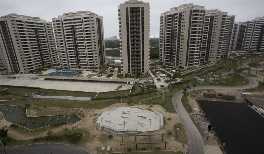 The Olympic Village stands ready in Rio de Janeiro, Brazil, Thursday, June 23, 2016. Local organizing committee spokesman Mario Andrada said that the complex, made up of 31 towers, represents the largest athletes' village in Olympic history. It also includes a massive cafeteria and gym, a post office, a first aid center and bank. (AP Photo/Silvia Izquierdo)
