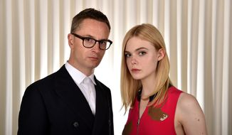 "In this June 15, 2016, photo, director Nicolas Winding Refn, left, poses with actress Elle Fanning to promote their film, ""The Neon Demon"" in Los Angeles. (Photo by Jordan Strauss/Invision/AP)"