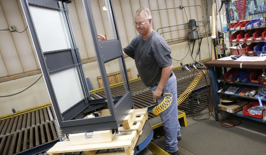 ADVANCE FOR USE SATURDAY, JUNE 25 - In this photo taken Tuesday afternoon June 14, 2016,  Dale Buschmann assembles an enclosure at Crenlo in Rochester, Minn. Crenlo, best known for making industrial and agricultural vehicle cabs for clients such as Caterpillar and John Deere, recently landed a subcontract with Lockheed Martin for 16 high-end, specialized electronics cabinets made by its Emcor enclosure division.  Buschmann has been with the company for 39 years.(Scott Jacobson/The Rochester Post-Bulletin via AP) MANDATORY CREDIT