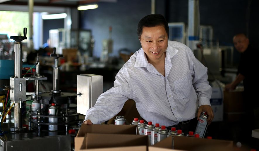 Jude Shao, CEO, fills orders of butane canisters, at American Energy Products Company, Friday, June 10, 2016, in Houston, Texas. American Energy manufactures butane canisters for Coleman and Sky Blue, their own brand name.   Shao spent a decade in a Chinese prison, uncertain when he'd be let go, and then was barred from leaving Shanghai for five more years. ( Gary Coronado/Houston Chronicle via AP) MANDATORY CREDIT