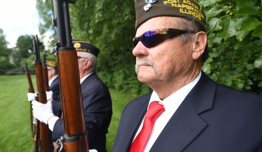 ADVANCE FOR USE SATURDAY, JUNE 25, 2016 AND THEREAFTER - In this June 7, 2016 photo, Lloyd McKee takes part in drills with Members of the Naperville VFW and American Legion honor guard in Naperville, Ill. They are certified to perform military funeral services for deceased veterans. The guard marched in its first Memorial Day parade this year and has performed services for eight burials.(Paul Michna/Daily Herald, via AP MANDATORY CREDIT; MAGS OUT; TV OUT