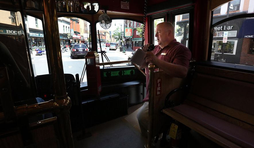 ADVANCE FOR WEEKEND EDITIONS, JUNE 25-26 - In this photo taken June 18, 2016, La Crosse Public Library archivist Barry McKnight discusses the dark history of downtown La Crosse, Wis., during a trolley tour of famous spots in the city that carry a past of prostitution, ghosts and murder. (Rory O'Driscoll/La Crosse Tribune via AP) MANDATORY CREDIT