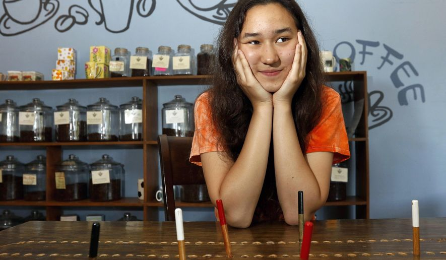 ADVANCE FOR USE SATURDAY, JUNE 25 - In this photo taken Friday, June 17, 2016, Wilson Jr. High School student Nylene Zabel, 14, poses an interview at Jenn's Java in Manitowoc, Wis. Zabel will be traveling to New York City to sing at Carnegie Hall on Saturday, June 25.  (Yi-Chin Lee/Herald-Times Reporter via AP) NO SALES; MANDATORY CREDIT