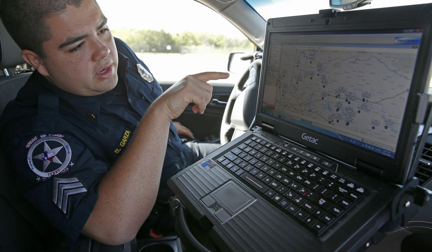 Sgt. Bernardo Garza, of the Wills Point Police Department, talks about a COPsync software inside his patrol car at Forney Community Park in Forney, Texas, Tuesday, June 21, 2016. The COPsync software allows officers to access local, state and federal law enforcement databases, gather information at the point of incident and share the data with all other officers on the COPsync Network in their patrol car. Former SMU defensive back Jack Brewer recruited eight athletes to invest in COPsync. (Jae S. Lee/The Dallas Morning News via AP)