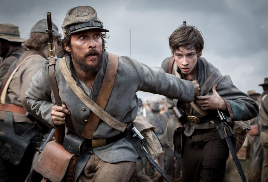 """This image released by STX Productions shows Matthew McConaughey and Jacob Lofland in a scene from """"The Free State of Jones."""" (Murray Close/STX Productions via AP)"""