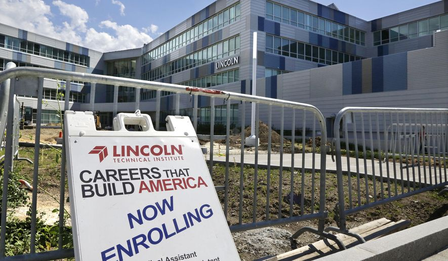 In this Wednesday, June 22, 2016 photo a sign rests near Lincoln Technical Institute, in Somerville, Mass. The nation's largest accreditor of for-profit colleges faces a vote Thursday that could lead to its demise, leaving hundreds of thousands of students at risk of losing access to federal financial aid. (AP Photo/Steven Senne)