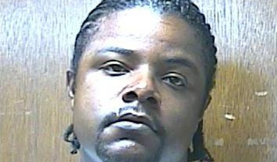 Darius Robinson is shown in this handout photo provided by the Oklahoma Department of Corrections. The Office of the Chief Medical Examiner in Oklahoma said in the report last week that Robinson died from asphyxiation caused by manual compression of the neck in April 2016, while he was held at Caddo County Jail. (Oklahoma Department of Corrections via AP)
