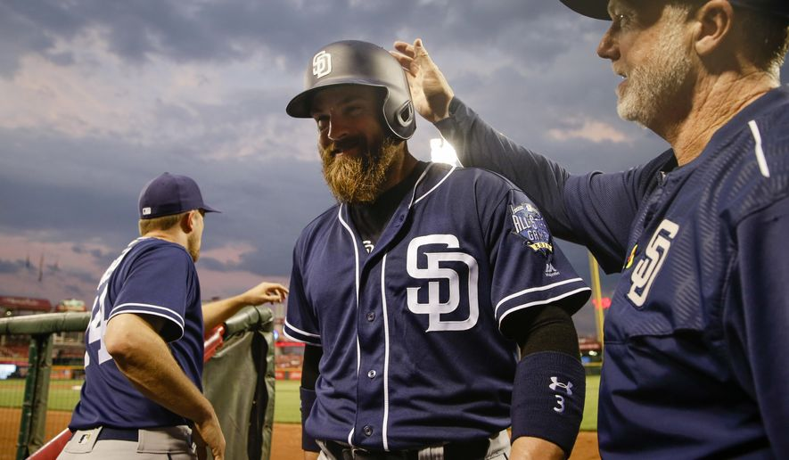 San Diego Padres' Derek Norris, center, smiles as he enters the dugout to celebrate his go-ahead three-run home run off Cincinnati Reds relief pitcher JC Ramirez in the sixth inning of a baseball game, Thursday, June 23, 2016, in Cincinnati. (AP Photo/John Minchillo)