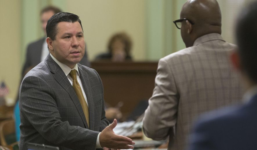 Assemblyman Eduardo Garcia, D-Coachella, left, thanks Assemblyman Mike Gipson, D-Carson, for voting for his bill to place a $3 billion bond measure on the November ballot that would pay for improvements at state and local parks, Thursday, June 23, 2016, in Sacramento, Calif. The Assembly approved the measure on a 55-14 vote sending it to the Senate. (AP Photo/Rich Pedroncelli)