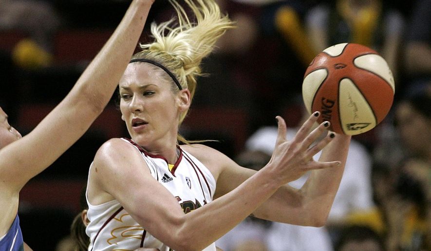 FILE - Seattle Storm's Lauren Jackson looks for room to pass in a WNBA basketball game in this Aug. 14, 2007, file photo. The Storm will honor three-time WNBA MVP Jackson by retiring her jersey on July 15, 2016. (AP Photo/Elaine Thompson, File)