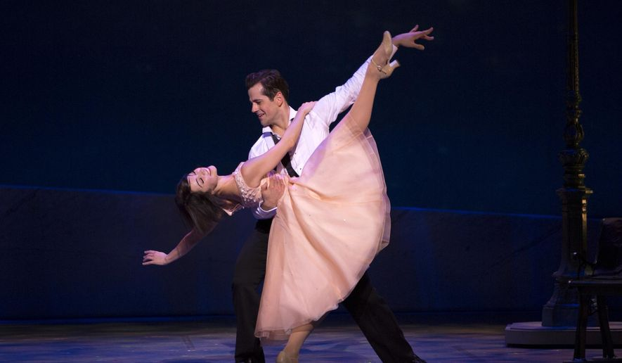 """This image released by Boneau/Bryan-Brown shows Leanne Cope and Robert Fairchild during a performance of """"An American in Paris."""" Producers announced the show will close on Jan. 1, 2017, after playing some 750 performances. (Angela Sterling/Boneau/Bryan-Brown via AP)"""