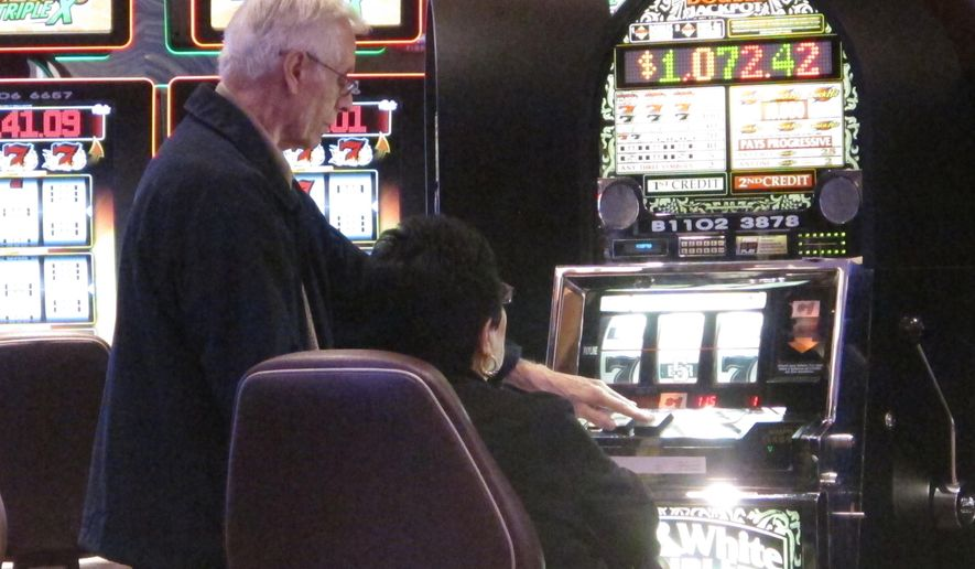 Gamblers play slot machines in a new high-limit slot lounge at the Tropicana Casino and Resort in Atlantic City N.J. on Thursday June 23, 2016. The new slot lounge is part of a $40 million renovation the casino recently completed. (AP Photo/Wayne Parry)
