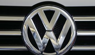 In this Feb. 14, 2013, file photo, the Volkswagen logo is seen on the grill of a Volkswagen on display in Pittsburgh. (AP Photo/Gene J. Puskar, File)