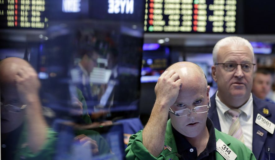 Trader Kevin Walsh, second from right, works on the floor of the New York Stock Exchange, Friday, June 24, 2016. U.S. stocks are plunging in early trading after Britons voted to leave the European Union. (AP Photo/Richard Drew)
