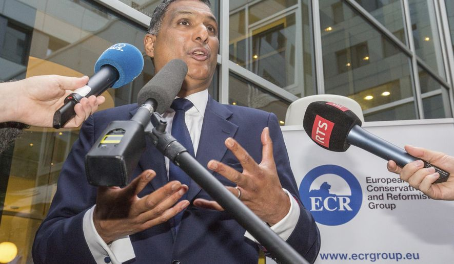 Leader of the European Conservatives and Reformists Syed Kamall speaks in Brussels on Friday, June 24, 2016. Britain entered uncharted waters Friday after the country voted to leave the European Union, according to a projection by all main U.K. broadcasters. (AP Photo/Olivier Matthys)