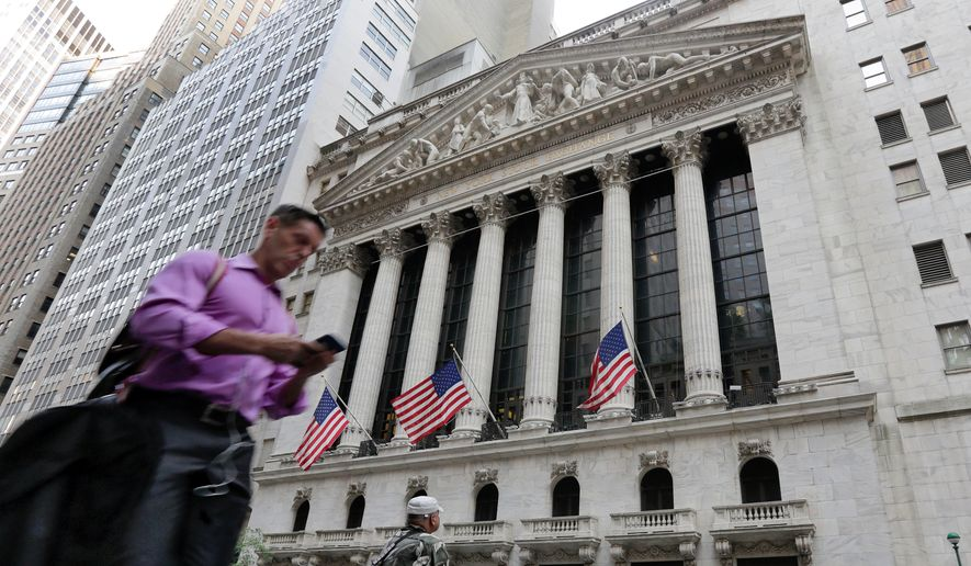 A man passes the New York Stock Exchange, Friday, June 24, 2016. Britain voted to leave the European Union after a bitterly divisive referendum campaign, toppling the prime minister Friday, sending global markets plunging and shattering the stability of a project in continental unity designed half a century ago to prevent World War III. (AP Photo/Richard Drew)
