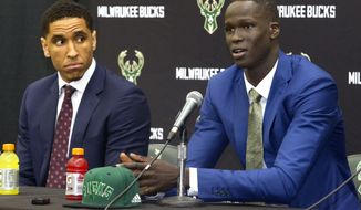 Milwaukee Bucks first round pick Thon Maker, right, speaks as second round pick Malcolm Brogdon listens during their introductory news conference, Friday, June 24, 2016, at the Milwaukee Bucks' training facility, in St. Francis, Wis.  (Sam Caravana/Milwaukee Journal-Sentinel via AP) MANDATORY CREDIT