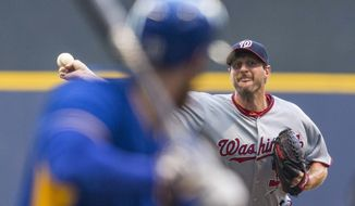 Washington Nationals' Max Scherzer pitchers to a Milwaukee Brewers batter during the first inning of a baseball game Friday, June 24, 2016, in Milwaukee. (AP Photo/Tom Lynn)