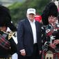 "The presumptive Republican presidential nominee  Donald Trump  poses with a bagpiper as he arrives at his revamped Trump Turnberry golf course in Turnberry Scotland Friday June 24, 2016. Trump saluting the United Kingdom's vote to leave the European Union, saying ""they took back their country, it's a great thing."" Trump arrived at his Turnberry golf course in Scotland a day after the so-called Brexit vote. (Andrew Milligan/PA via AP) UNITED KINGDOM OUT  NO SALES NO ARCHIVE"