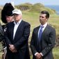 Donald Trump, center, with his sons Eric, left, and Donald Trump Jr. during a ceremony at his revamped Trump Turnberry golf course in Turnberry Scotland on Friday, June 24, 2016. (Jane Barlow/PA via AP) ** FILE **