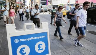A signboard indicates that euros and pounds can be exchanged, Friday, June 24, 2016, at a money exchange in New York. Britain voted to leave the European Union after a bitterly divisive referendum campaign, toppling the government Friday, and sending global markets plunging. (AP Photo/Mark Lennihan)