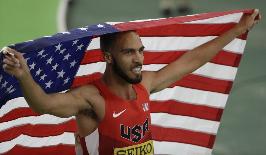 FILE - In this March 19, 2016, file photo, United States' Boris Berian holds the U.S. flag after he won the men's 800-meter sprint final during the World Indoor Athletics Championships, in Portland, Ore.   Nike is dropped its lawsuit against Boris Berian over what brand of gear he wears, Thursday, June 23, 2016, freeing the middle-distance runner to concentrate on the Olympic Trials next week. Berian is emerging as one of the feel-good stories with the Rio de Janeiro Olympics on the horizon.  (AP Photo/Rick Bowmer, File)