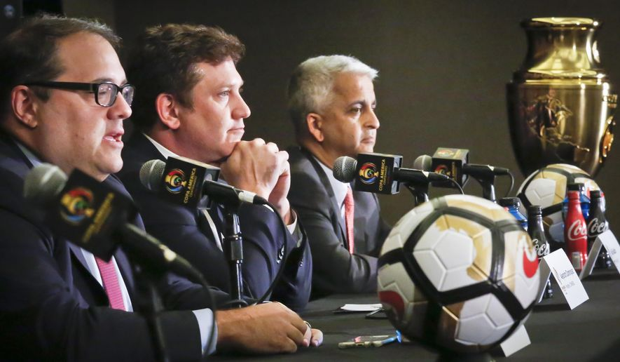 From left to right, CONCACAF President Victor Montagliani, CONMEBOL President Alejandro Dominguez and U.S. Soccer Federation President Sunil Gulati hold a press conference with the Copa America Centenario championship trophy on display, Friday June 24, 2016, in New York. The final between Argentina and Chile is set on Sunday, June 26 at MetLife Stadium in East Rutherford, N.J. (AP Photo/Bebeto Matthews)