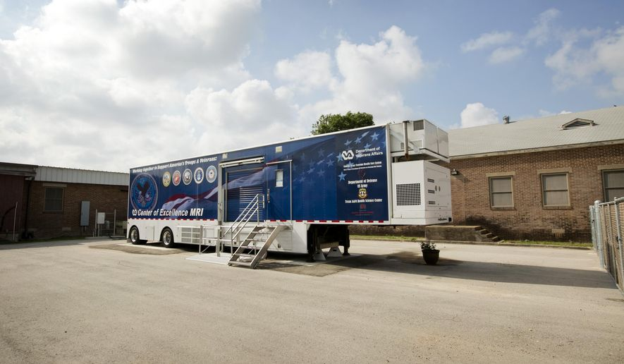 """In this photo taken Aug. 4, 2014, The Center of Excellence mobile MRI machine is parked at the Olin E. Teague Veterans' Center in Temple, Texas. Nearly a decade after the Department of Veterans Affairs bought the once cutting-edge, mobile MRI system, internal investigators have concluded that research efforts at the VA Waco Center of Excellence represented """"a waste of taxpayers' funds"""" and were an example of """"poor stewardship."""" (Jay Janner/Austin American-Statesman via AP)"""