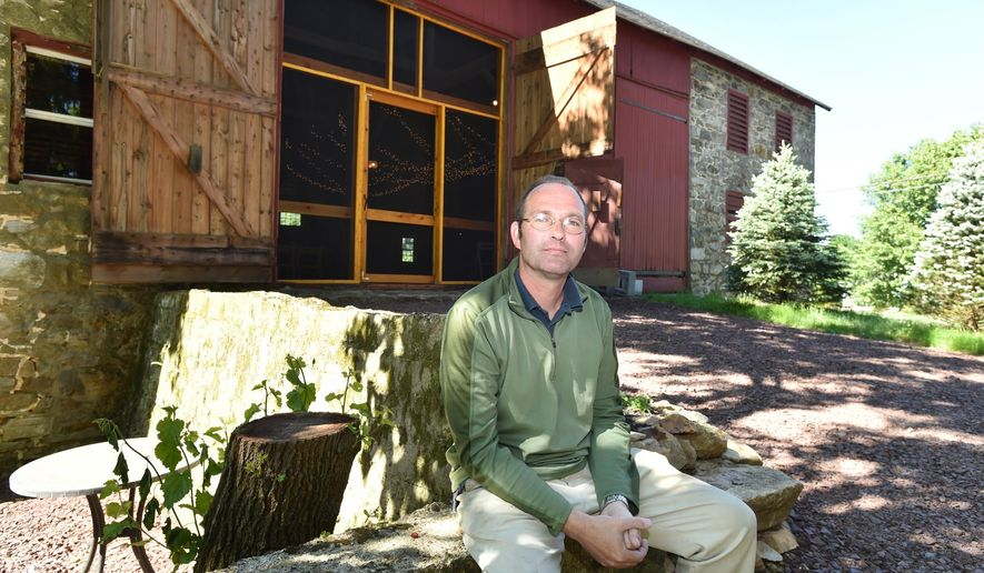 ADVANCE FOR SATURDAY, JUNE 25, 2016, AND THEREAFTER - Meadowbrook Farm owner Paul Sarver sits in front of a refurbished barn where he's hosted weddings and other events at the bed-and-breakfast property he and his wife run, on June 10, 2016, in Zionsville, Pa. In picturesque areas with an agriculture heritage, regulatory hurdles and complaints from neighbors sometimes frustrate efforts by entrepreneurial property owners to host barn weddings and other agritourism activities. (April Bartholomew/The Morning Call via AP) THE EXPRESS-TIMES OUT; WFMZ OUT; MANDATORY CREDIT