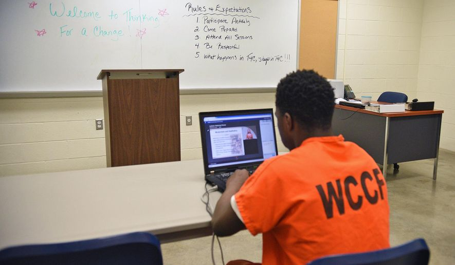 ADVANCE FOR SATURDAY, JUNE 25, AND THEREAFTER -  In this June 3, 2016 photo, an inmate takes a class toward earning a high school diploma at the Washington County Correctional Facility in Washington, Pa. Under both Pennsylvania state law and federal law, jail inmates under age 21 are entitled to a free public education, and can enroll in school programs toward earning a high school diploma or GED credential. (Celeste Van Kirk/Observer-Reporter via AP) MANDATORY CREDIT