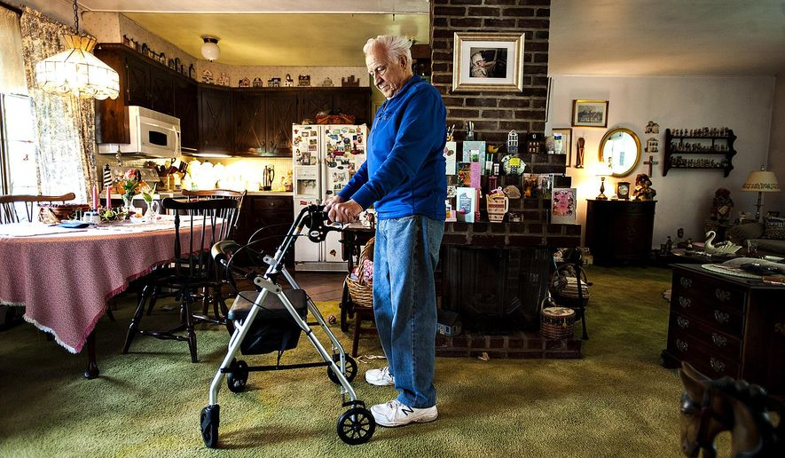 ADVANCE FOR RELEASE SATURDAY, JUNE 25, 2016, AT 3:01 A.M. EDT. AND THEREAFTER - In this May 10, 2016, photo, Polio survivor, Nick Hovemeyer stands in his home in Bristol, Pa. Hovemeyer had Polio when he was a boy, recovered then later in life his symptoms came back. (Rick Kintzel/Bucks County Courier Times via AP) MANDATORY CREDIT
